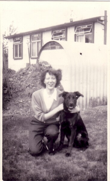 Woman With Dog In Garden At Sighthill c.1956