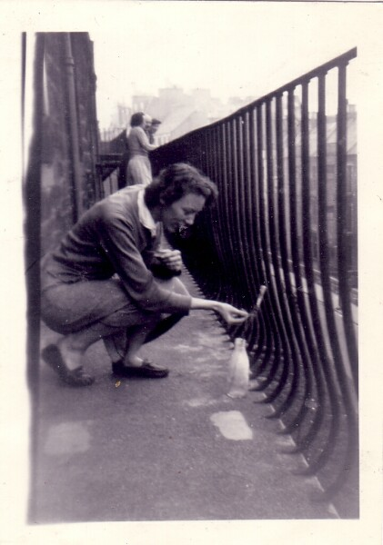 Young Woman Lighting A Firework At 42 Dumbiedykes Road c.1955
