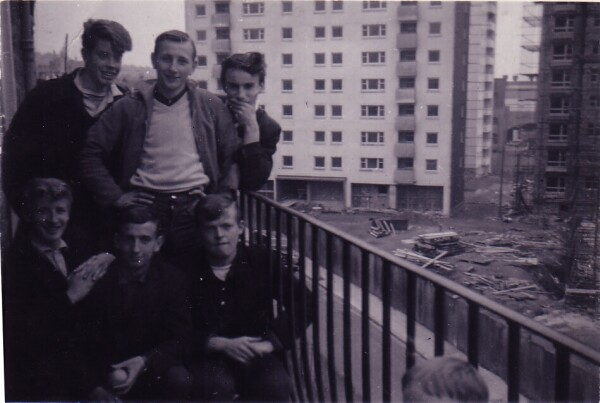 Group Of Teenagers On Tenement Balcony New Flats In Background c.1960
