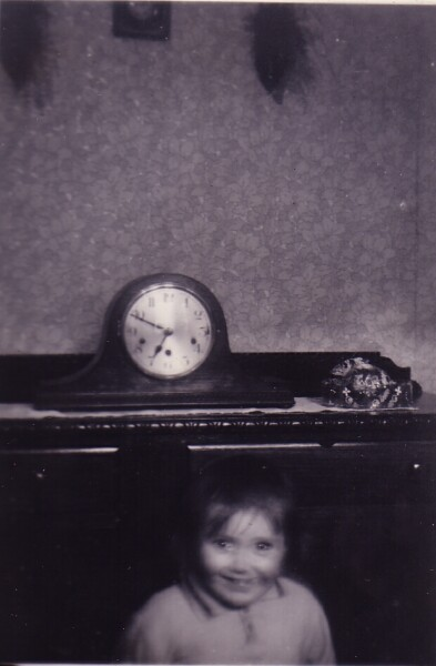 Young Girl In Front Of Clock At Home In 42 Dumbiedykes Road 1954