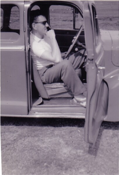 Driver Sitting In Car With Door Open c.1959