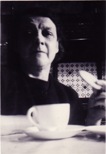 Woman Having Cup Of Tea And Biscuit c.1955