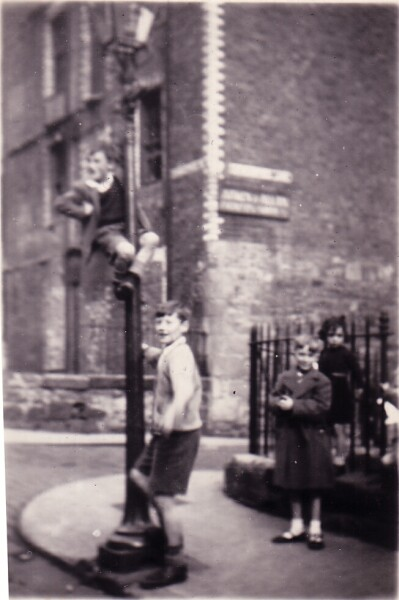 Boys On Street Corner Climbing Lamp Post c.1954