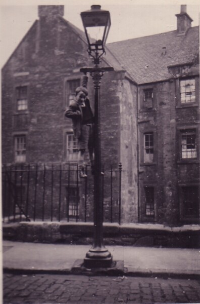 Boy Climbing Lamp Post On Corner Of Dumbiedykes Lane And Dumbiedykes Road c.1954