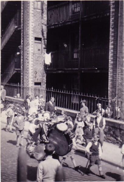 John Codona One-Man Band Playing Along Dumbiedykes Road c.1954
