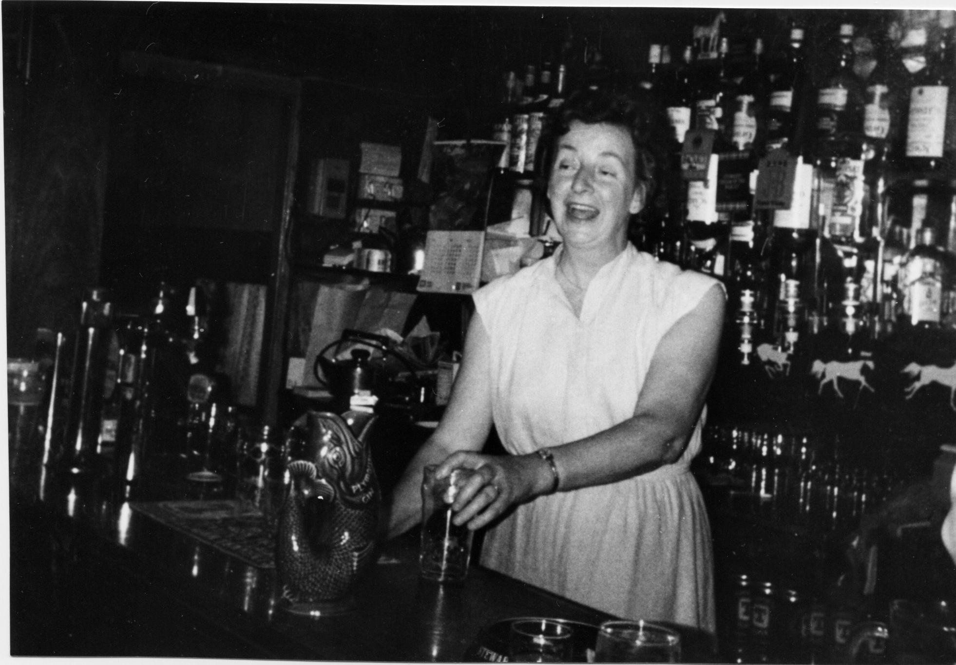 Barmaid Working At The Bar Of The White Horse, late 1970s