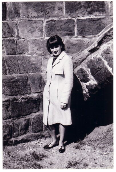 Young Woman Standing By Wall c.1965