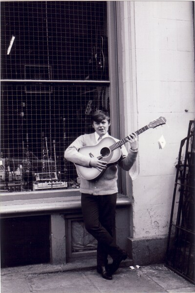 Young Man With Guitar Outside Pete Seaton's Music Shop c.1965
