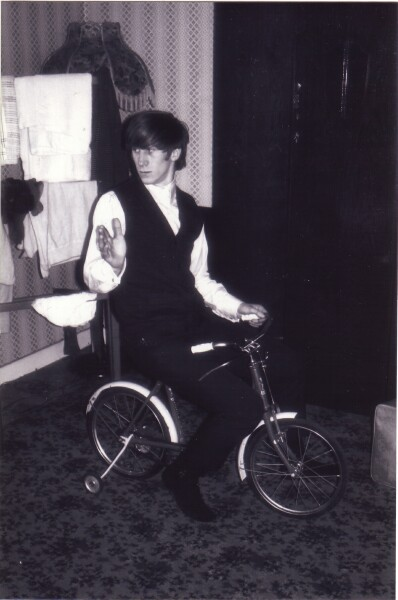 Young Man On Child's Bike In The House c.1965