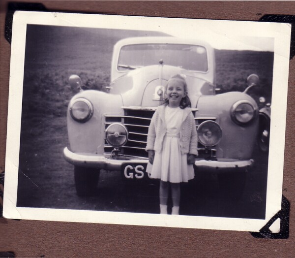 Young Girl Standing In Front Of Car 1965