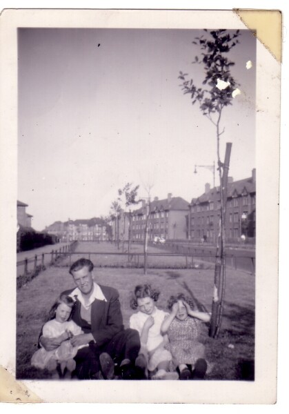 Man With Children Sitting In Patch Of Grass 1950s