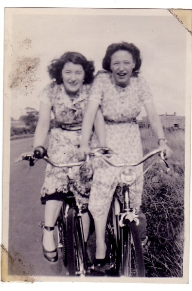 Two Young Women On Bicycles, late 1940s
