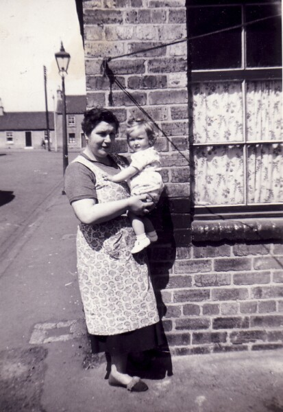 Woman Standing At Street Corner With Young Child 1959