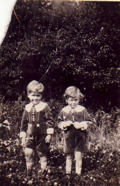 Two Young Brothers Standing In Garden Wearing Matching Suits 1928