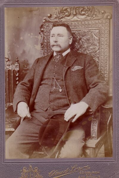 Studio Portrait Gentleman Sitting On High-Backed Chair 1890s