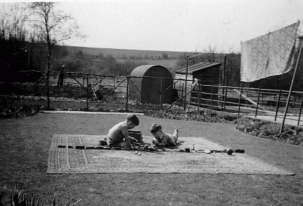 Two Brothers Playing With Their Toys In The Back Green c.1953