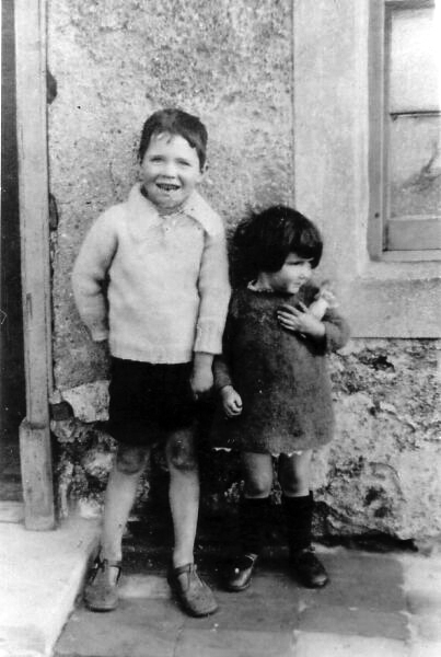 Young Brother And Sister Standing Outside House At 10 East Side, Prestonpans 1926