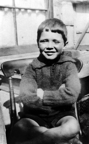 Young Boy Sitting Cross-Legged On Chair At 10 East Side, Pretonpans c.1926