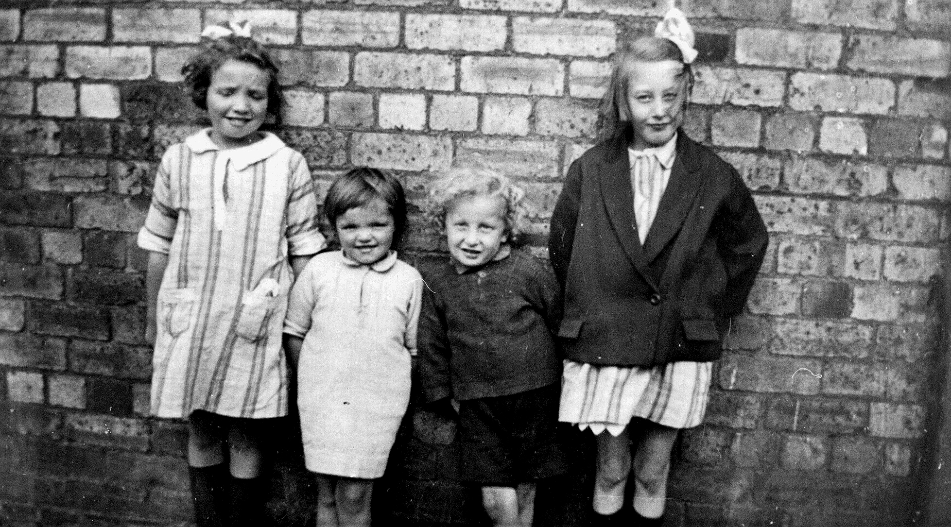 Children Leaning Against Wall Of Dobson & Molle 1925