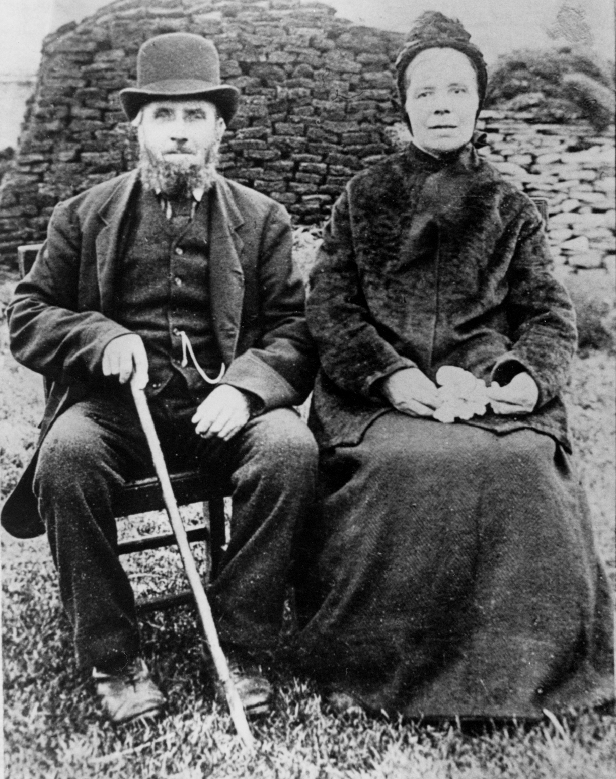 Couple Sitting In Front Of Peat Stack 1920s