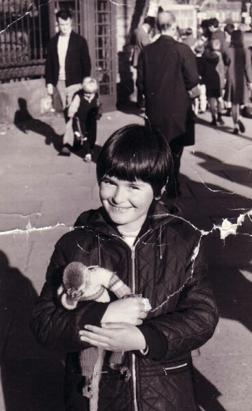 Child Holding Monkey In Woollen Suit 1972