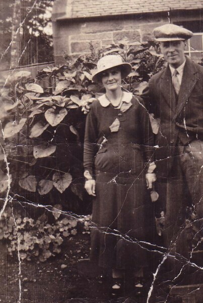 Couple Standing By Foliage 1922