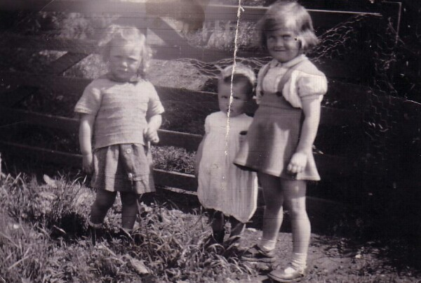 Children Standing By Gate 1947