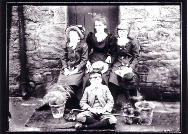 Family Portrait Outdoor Sitting In Front Of Doorway c.1900