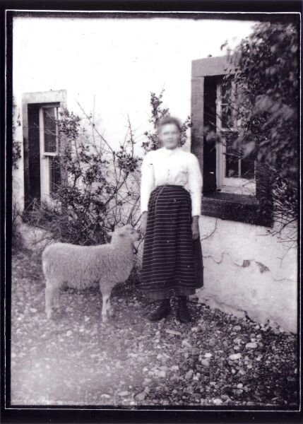 Girl Standing Outside House With Pet Lamb c.1900