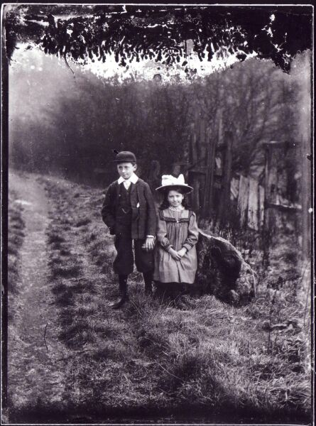 Boy And Girl Posing By Tree Stump On Side Of Rough Path c.1900