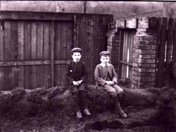 Two Boys Sitting On A Tree Trunk At Bell's Mill c.1890