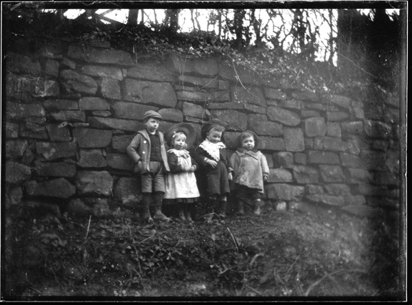 Group Of Young Children Leaning Against Front Of Wall c.1890