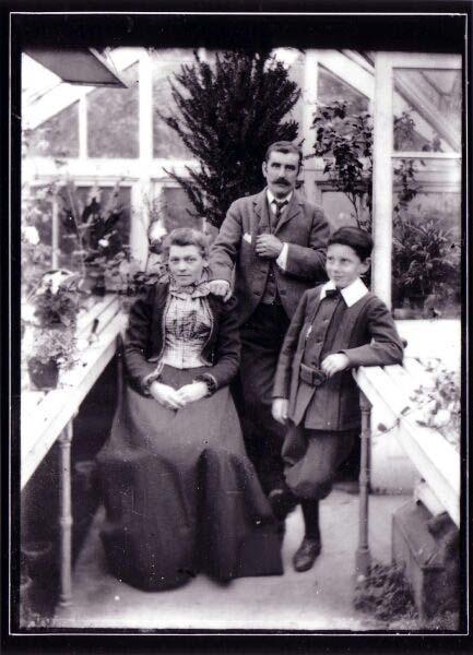 Family Portrait Taken Inside Glasshouse c.1900