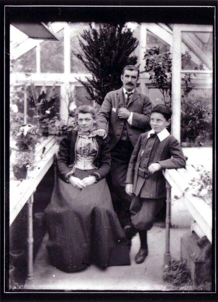 Family Portrait In Glasshouse c.1900