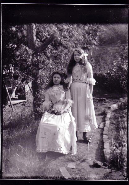 Two Young Women Posing In Garden, late 1890s