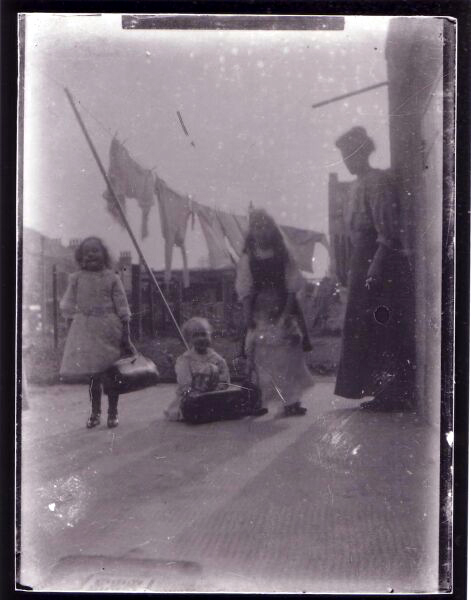 Children At Play In The Back Green On Washing Day c.1900