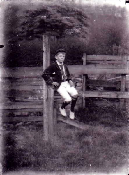 Schoolboy Reposing On Fence, early 1900s