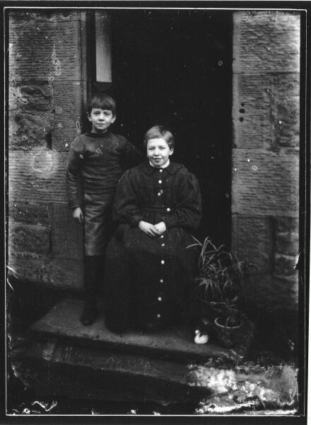 Two Boys On Entrance Steps In Doorway c.1900