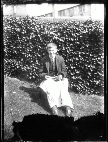 Young Man Embroidering Tablecloth In Garden At Belford Terrace c.1912
