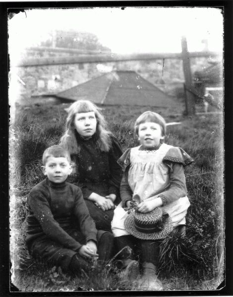 Three Children Seated Outdoor 1890s