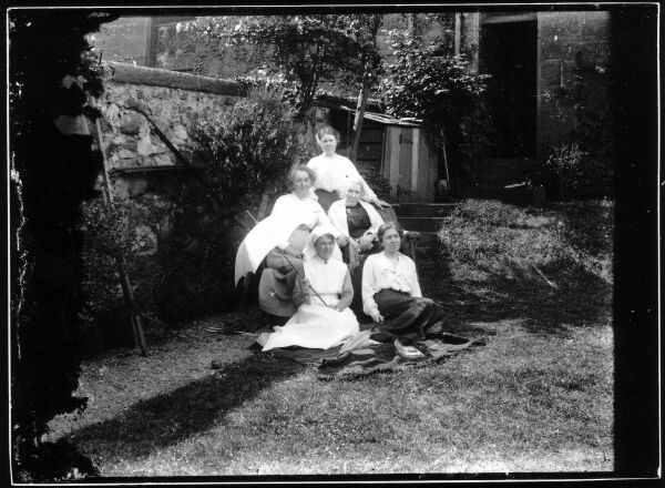 Friends And Nurse Reposing In Garden At Belford Terrace, early 1900s