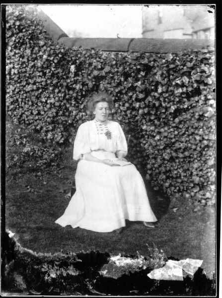 Woman Reading Book In Garden, early 1900s