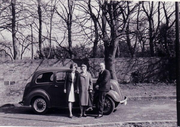 Family Standing By Car, late 1960s