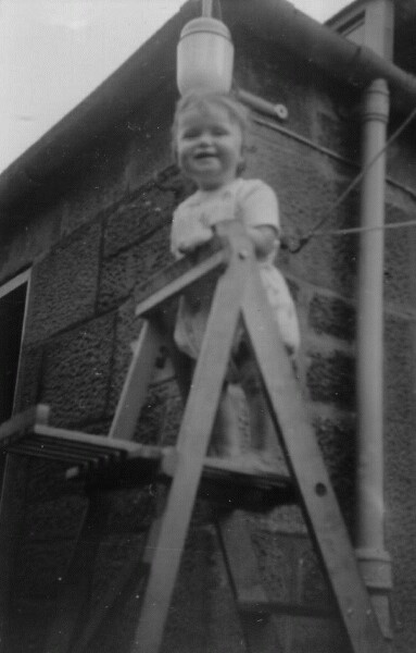 Young Girl Climbing Up Ladder Outside Home At 28 Upper Gilmore Place 1963