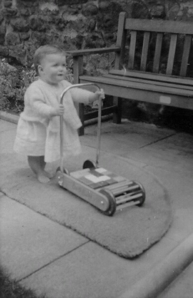 Young Child Pushing Building Block Trolley In Garden Of Home At 28 Upper Gilmore Place, July 1963
