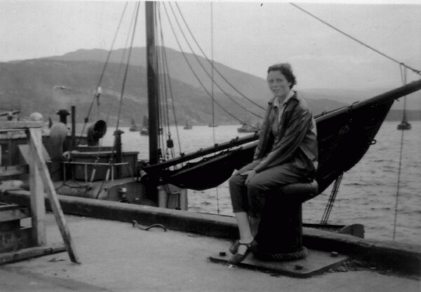 Woman Sitting On Bollard By Pier, August 1958