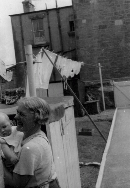 Grandmother Holding Her Grandson In Back Garden Of Her Home At 3 Hawthorn Terrace c.1957