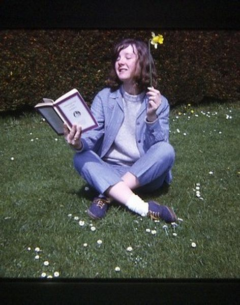 Young Woman Posing Reading Plato With Daffodil In Hand In The Grounds Of University Hall At St Andrews 1968
