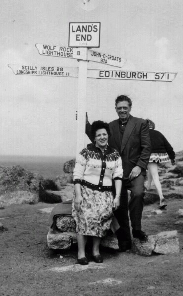 Couple Standing Under Signpost At Land's End 1961
