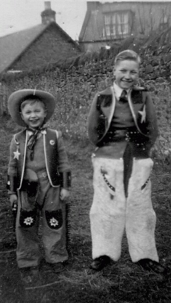 Two Boys In Cowboy Outfits 1950